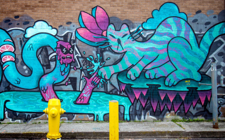 Cyan and Magenta Mural with a Cat and Snake :: I've Been Bit! Travel Blog