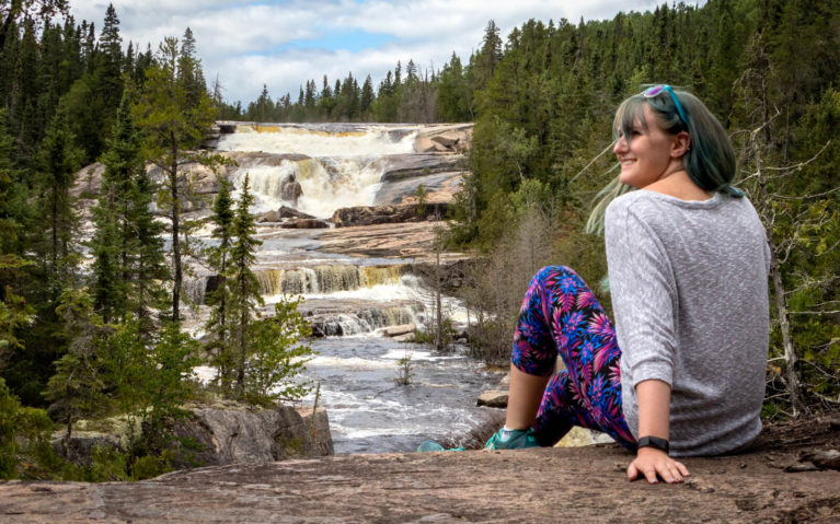 Lindsay Sitting In Front of Dog Falls in Thunder Bay :: I've Been Bit! Travel Blog