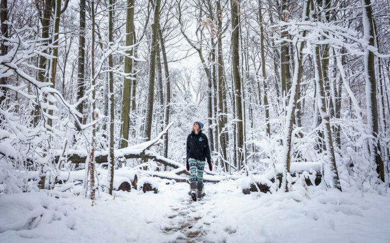Lindsay Hiking Along a Snowy Trail Surrounded By Tall Trees :: I've Been Bit! Travel Blog