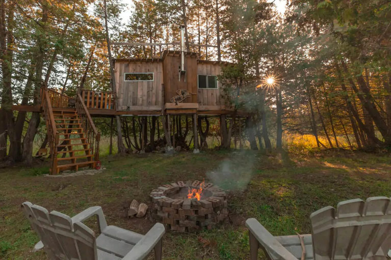View of the Ottawa Treehouse Cabin from the Fire Pit - Image from Airbnb :: I've Been Bit! Travel Blog
