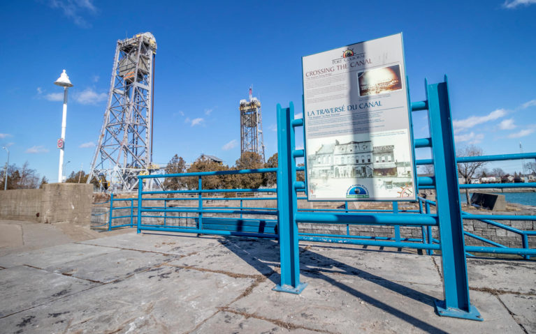 One of the Interpretive Signs Along the Port Promenade with the Lift Bridge in the Background :: I've Been Bit! Travel Blog