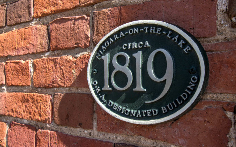 Sign of Heritage Architecture on Red Brick Wall :: I've Been Bit! Travel Blog