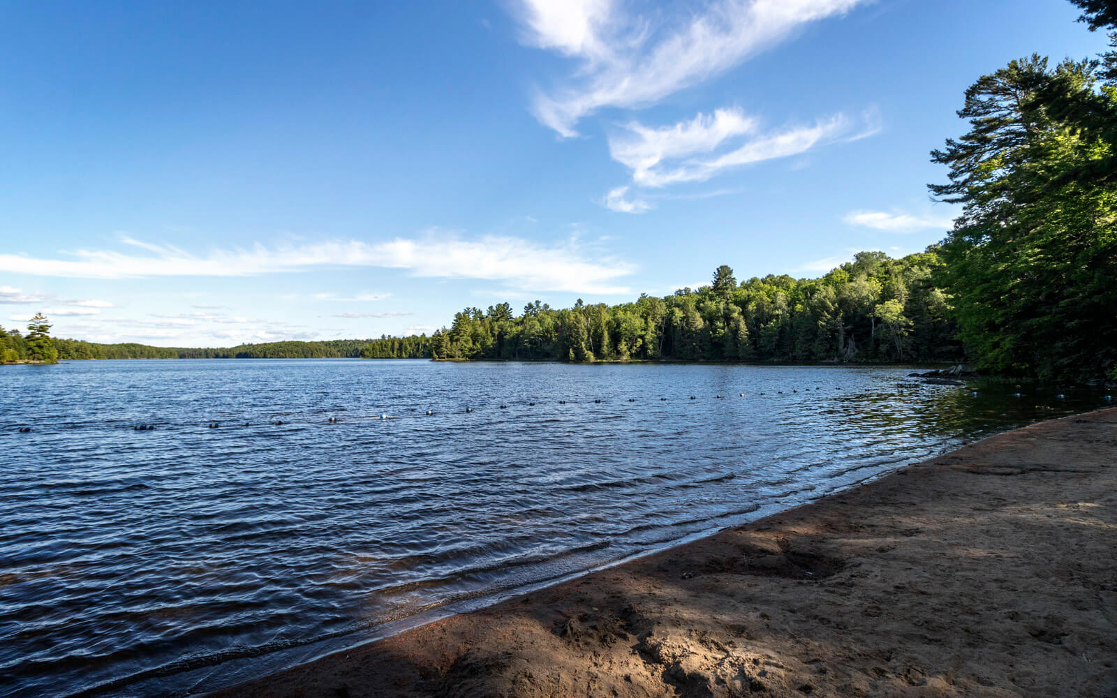 Blue Skies Over the Calm Waters of Silent Lake Provincial Park :: I've Been Bit! Travel Blog