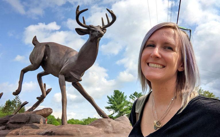 Lindsay Smiling With the Buck Statue in Buckhorn :: I've Been Bit! Travel Blog