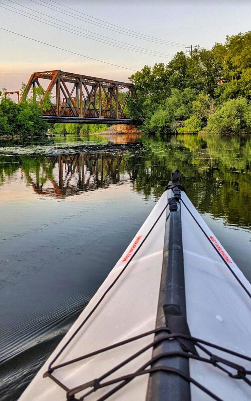Kayak Facing the Railway Bridge on Little Lake in Peterborough at Golden Hour :: I've Been Bit! Travel Blog