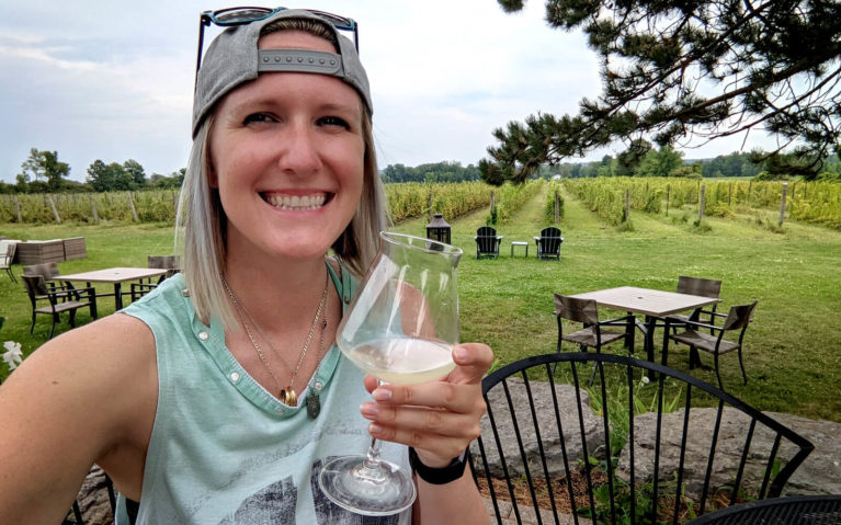 Lindsay Holding a Glass of Wine at Bergeron Estates in Greater Napanee :: I've Been Bit! Travel Blog